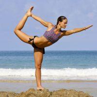 Girl on the Beach Doing Yoga